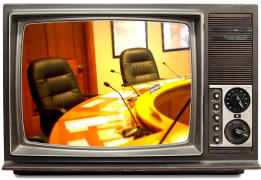 Television showing a live meeting